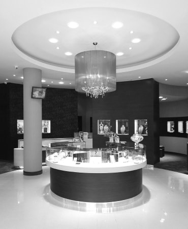 Black and white image of a Peter Jackson showroom counter